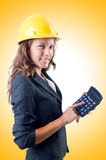 Female builder with calculator Royalty Free Stock Photo