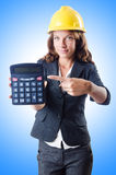 Female builder with calculator Stock Photo