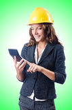Female builder with calculator Stock Images