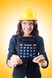 Female builder with calculator Royalty Free Stock Images