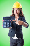 Female builder with calculator on the white Royalty Free Stock Image