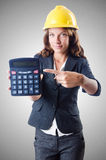 Female builder with calculator on white Royalty Free Stock Images