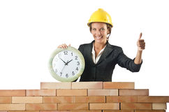 Female builder and clock Stock Photo
