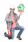 Female builder displaying energy sign Stock Images