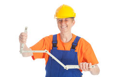 Female builder with folding rule Royalty Free Stock Images