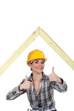 Female builder with an A-frame Stock Photo