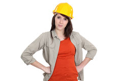 Female builder with hands on hips Stock Photography