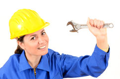 Female builder with helmet and big wrench. Female builder with helmet and wrench Royalty Free Stock Images
