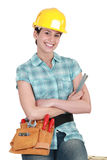 Female builder. With her arms folded royalty free stock photos