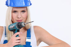 Female builder holding  drill Royalty Free Stock Images