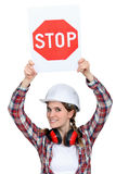 Female builder holding stop sign Stock Image