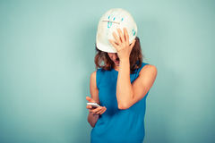 Female builder on the phone Royalty Free Stock Photography