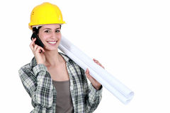 Female builder with plans Stock Images