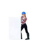 Female builder pointing at poster Royalty Free Stock Photo