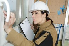 Female builder superving work stock photo