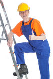 Female builder thumb up Stock Photo