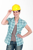 Female builder touching hat Stock Photography