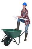 Female builder with wheelbarrow Royalty Free Stock Images