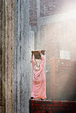 Female building worker carry some rubble on her head Royalty Free Stock Image
