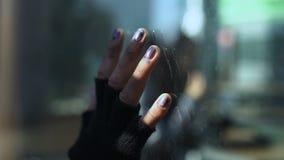 Female hand on restaurant window glass, poor segment of population, problem