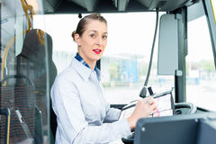 Female bus driver in drivers seat Stock Photo