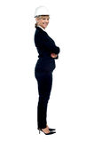 Female business architect posing sideways Royalty Free Stock Photos