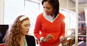 Female business executive discussing over digital tablet. In the office 4k stock footage