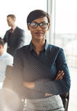 Female business executive with folded arms Stock Image