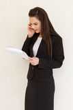 Female business executive with her phone Stock Photo