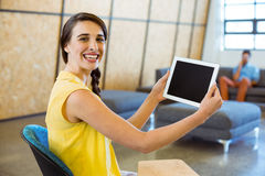 Female business executive holding digital tablet Royalty Free Stock Photo