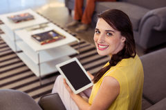 Female business executive holding digital tablet Stock Photo