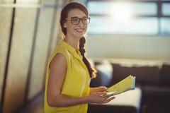 Female business executive holding documents Stock Images
