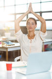 Female business executive performing yoga Royalty Free Stock Photography