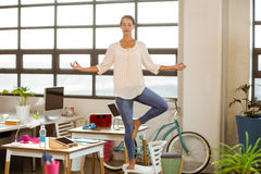 Female business executive performing yoga Stock Images