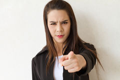 Female business executive point her finger toward audience Stock Photography