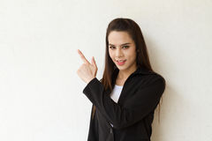 Female business executive pointing at blank space Royalty Free Stock Photography