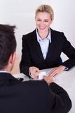 Female business executive smiling Stock Image