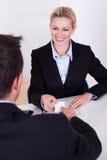 Female business executive smiling Stock Image