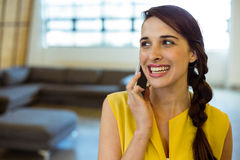 Female business executive talking on mobile phone Royalty Free Stock Images