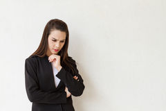 Female business executive thinking with negative mood Stock Photography