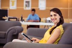 Female business executive using digital tablet Stock Photos