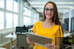 Female business executive using digital tablet Royalty Free Stock Photos