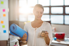 Female business executive using mobile phone Royalty Free Stock Images