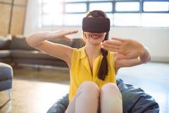 Female business executive using virtual glasses Stock Photography