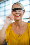 Female business executive using virtual reality video glasses Stock Image