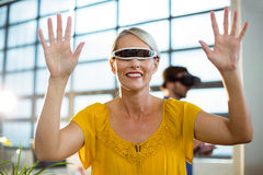 Female business executive using virtual reality video glasses Royalty Free Stock Photography