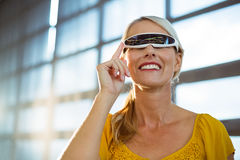 Female business executive using virtual reality video glasses Royalty Free Stock Image