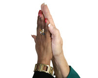 Female Business High Five with Path. Closeup of business women's hands giving a high five.  Isolated with clipping path Royalty Free Stock Image