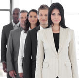 Female business leader. With Business team stock photo