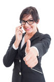 Female business manager showing like and talking on smartphone Stock Photography